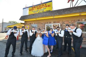 Bridal Party outside of Skyway Dog House, eating hot dogs with bride and groom.
