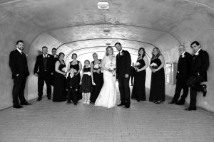 Bride and groom with bridal party lined up in a tunnel in downtown Chicago.