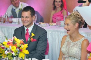Bride and groom laughing at the best mans speech.