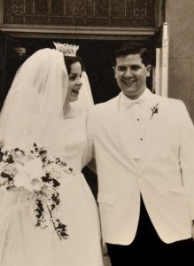 Bride and groom from the 1960's coming out of church on their wedding day.