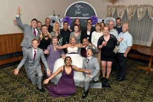 Fun extended family photo at wedding reception.