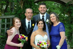 Bride and groom with family at Lake Katherine Nature Center.