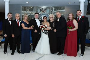 Bride and groom with their immediate family members.