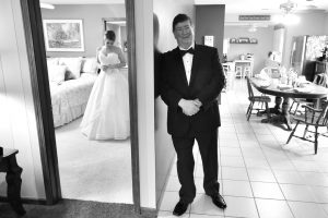 Dad waiting for his first look outside of the brides bedroom door.