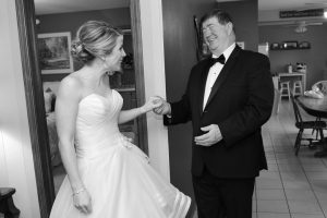 Dad seeing his daughter all dressed up for her wedding for the first time.