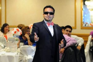 Groomsman being silly as he is introduced at the wedding reception.