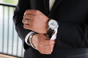 Groom putting new watch on.