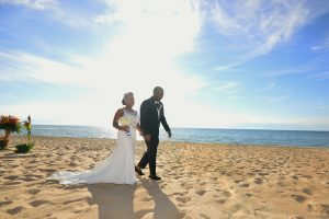 Bride and Groom walking on the beach in Chicago.
